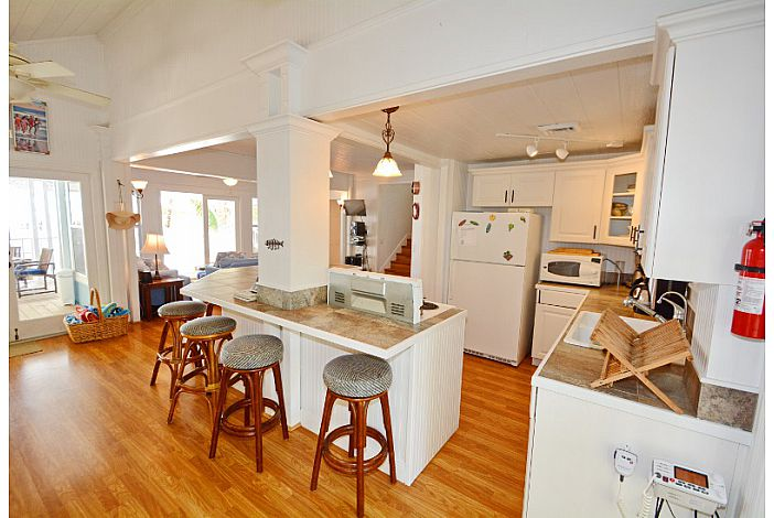Fully equipped kitchen overlooks living