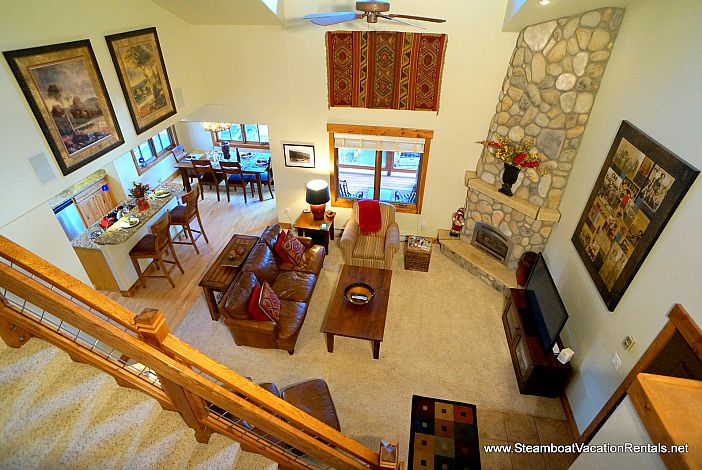 View of Living room and fireplace from top floor