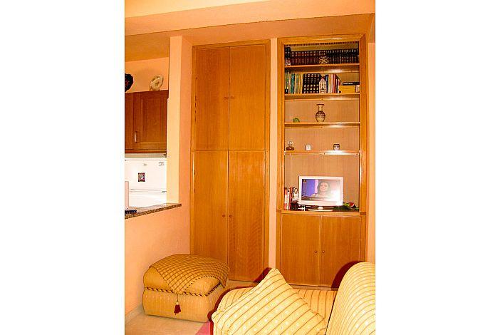 Sala de estar com cozinha aberta