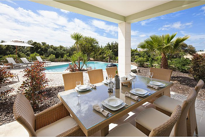 Dining terrace by pool