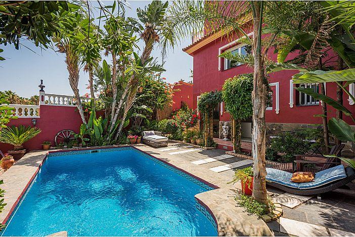 Lush gardens surrounding the pool area