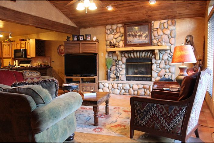 Living Room w/ wood burning fireplace & TV