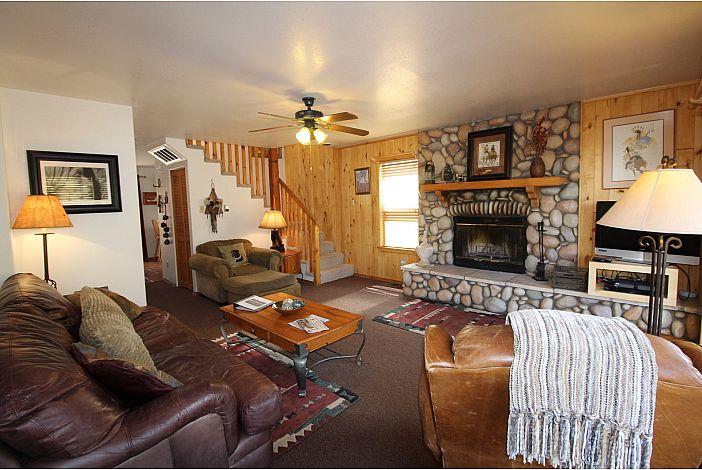 Living room w/ Wood burning Fireplace