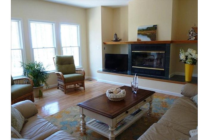 Spacious Family Room with Fireplace, Flat Screen TV and spectacular views of the Chesapeake Bay.