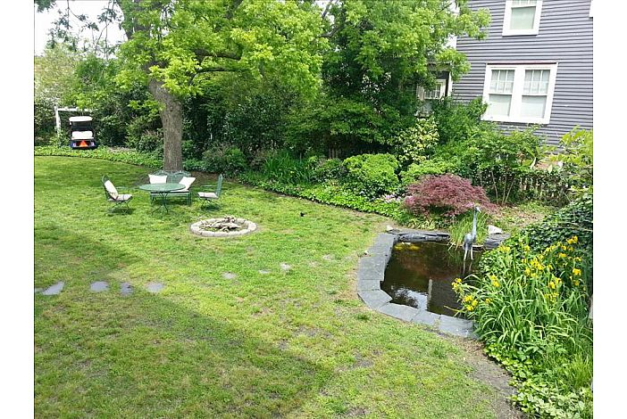 Offering large yard with firepit and pond