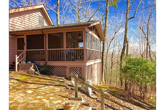 Large covered back deck with nice wooded view