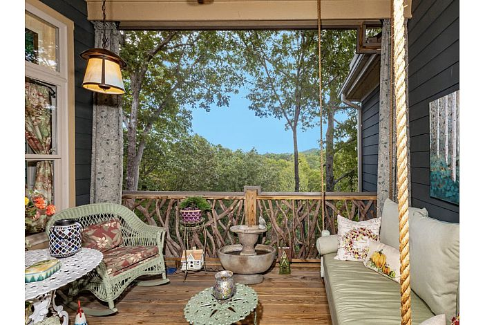 Comfortable and charming swing in screened porch