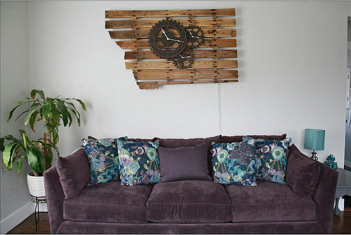 Handmade, light up Montana Sign above the couch.