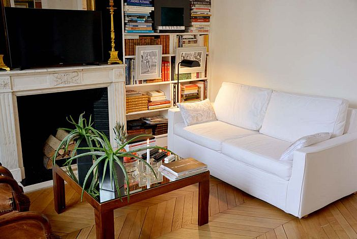 Another view of the living room with TV and sofa