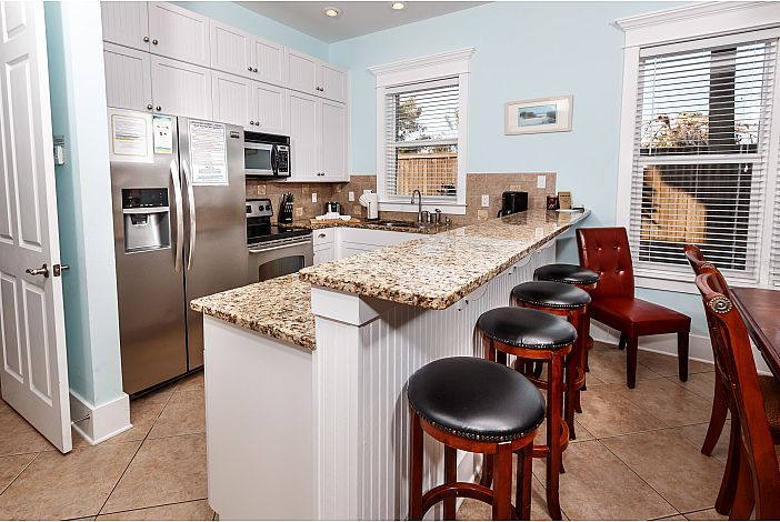 Fully stocked Kitchen with Large Breakfast Bar