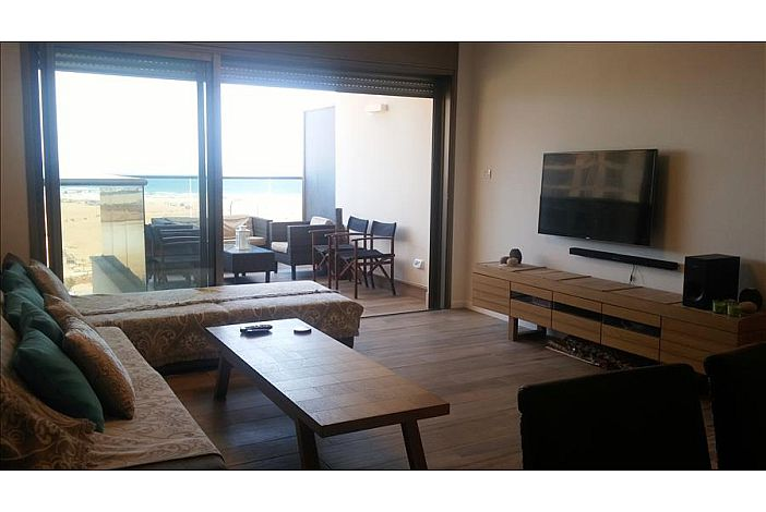 Spacious open plan living area w/ sea view