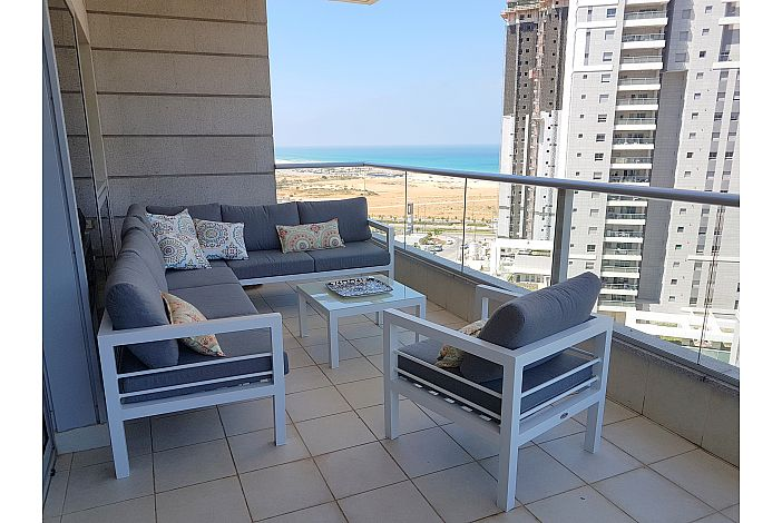 Spacious balcony with sea and reserve views
