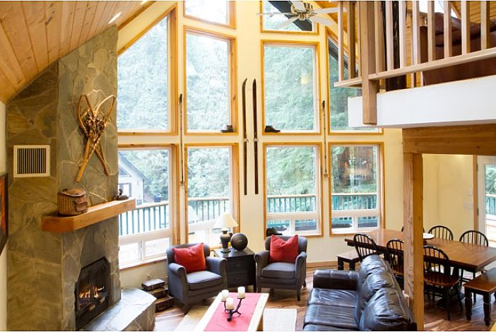 Great room with wall of windows and Rock Fireplace