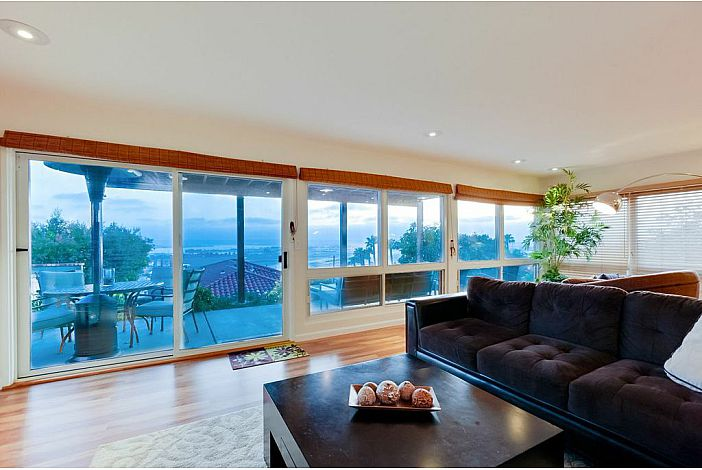 Floor-to-ceiling bay windows facing San Diego