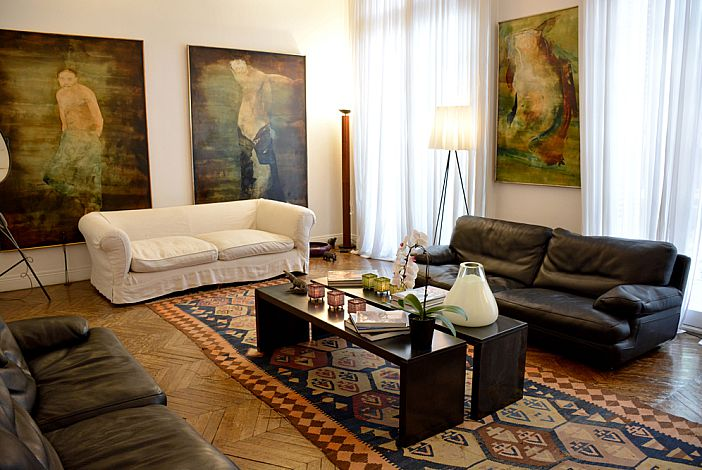 Spacious living room filled with artworks