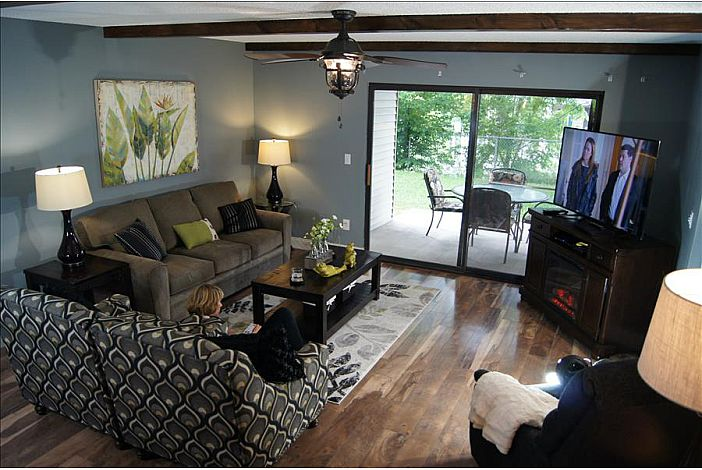 Open Living Space With Fireplace and 60inch HDTV